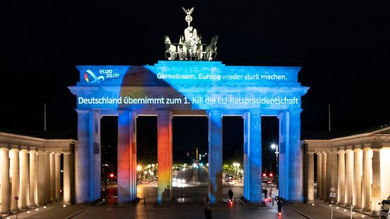 "The Brandenburg Gate in Berlin is illuminated with the motto of Germany's Presidency of the Council of the European Union - a ""Together for Europe's recovery""."