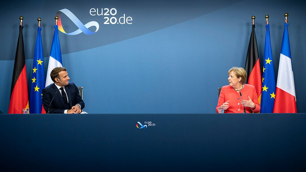 Chancellor Angela Merkel gives a press conference with French President Emmanuel Macron.