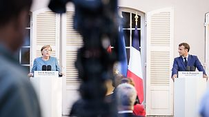 Chancellor Angela Merkel and French President Emmanuel Macron at a joint press conference