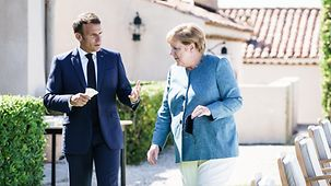 Chancellor Angela Merkel in discussion with French President Emmanuel Macron