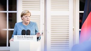Chancellor Angela Merkel speaks at a press conference.