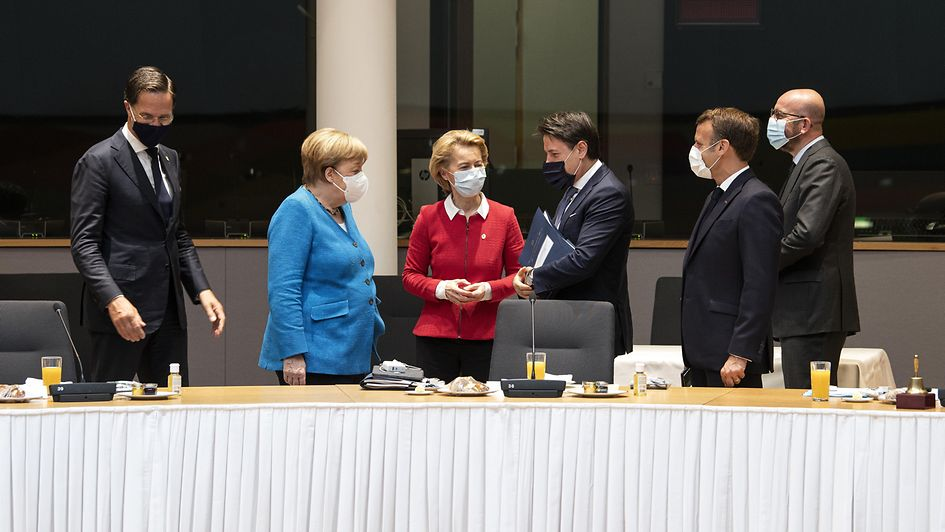 Chancellor Angela Merkel in discussion during a meeting of the European Council