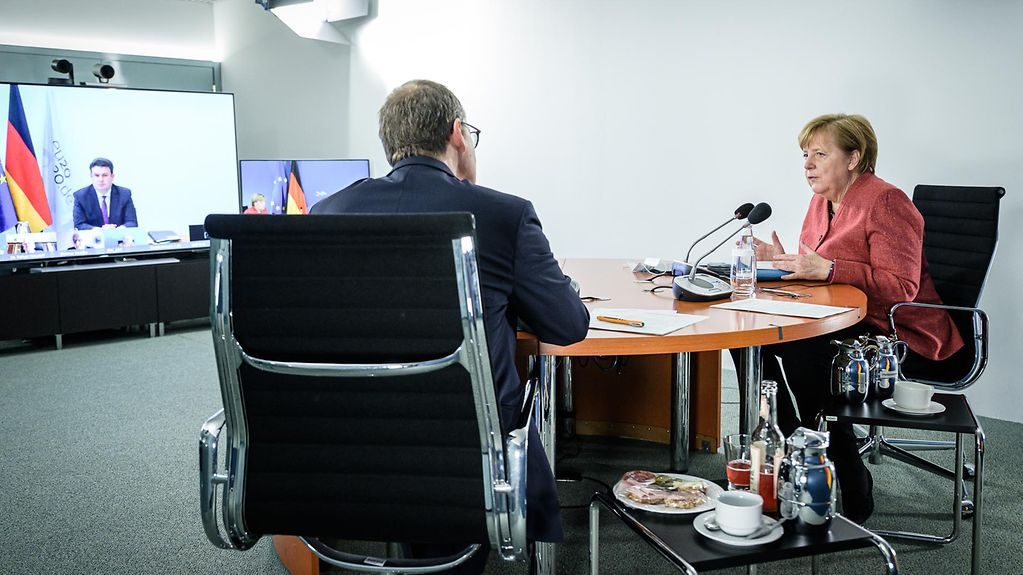 Chancellor Angela Merkel with Michael Müller, Berlin's Governing Mayor, during the video conference