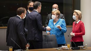 Chancellor Angela Merkel speaks to other heads of government during the European Council meeting in Brussels.