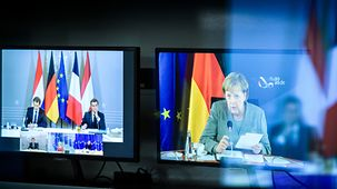 Two monitors in the engineering service room of the situation centre showing the video conference with Angela Merkel, Ursula von der Leyen, Charles Michel, Mark Rutte, Sebastian Kurz and Emmanuel Macron