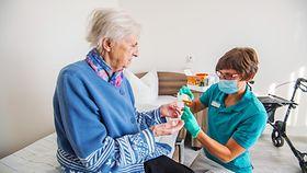 Photo shows a nurse and a care patient