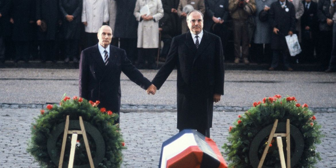 German Chancellor Helmut Kohl (right) and French President Francois Mitterrand at the French National Cemetery in Douaumont, holding hands while honouring soldiers from both countries who died in the two World Wars.