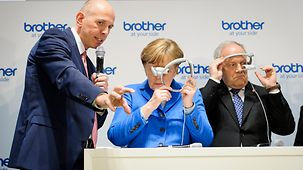 Chancellor Angela Merkel at the Brother stand