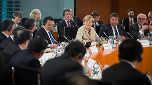 Chancellor Angela Merkel before the start of the plenary session of the Sino-German government consultations