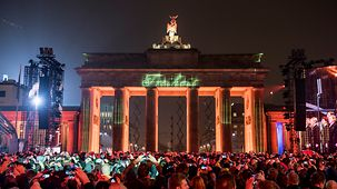"The word ""Freiheit"" - peace - is projected onto the Brandenburg Gate."