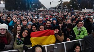 Visitors with a German flag