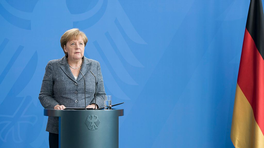 Chancellor Angela Merkel delivers a statement to the press on the attempted military coup in Turkey