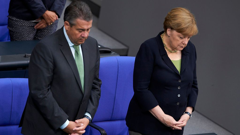 Chancellor Angela Merkel and Federal Foreign Minister Sigmar Gabriel observe a one-minute silence in the German Bundestag to pay tribute to former Chancellor Helmut Kohl, who died last week.