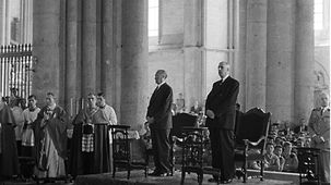 Chancellor Konrad Adenauer (at left) and French President Charles de Gaulle (at right) during high mass in Reims Cathedral