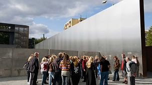"Visitors to the memorial site ""Berlin Wall"" at the Bernauer Straße"