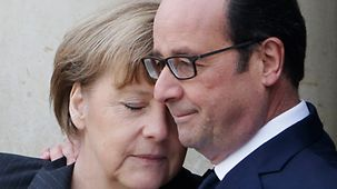 President François Hollande greets the Chancellor in Paris with a hug.
