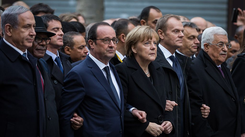 Chancellor Angela Merkel, French President François Hollande and other heads of state and government march in Paris.