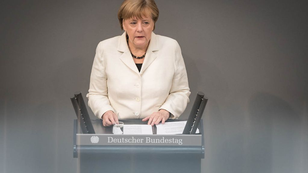 Chancellor Angela Merkel giving her policy statement in the German Bundestag on the upcoming NATO Summit