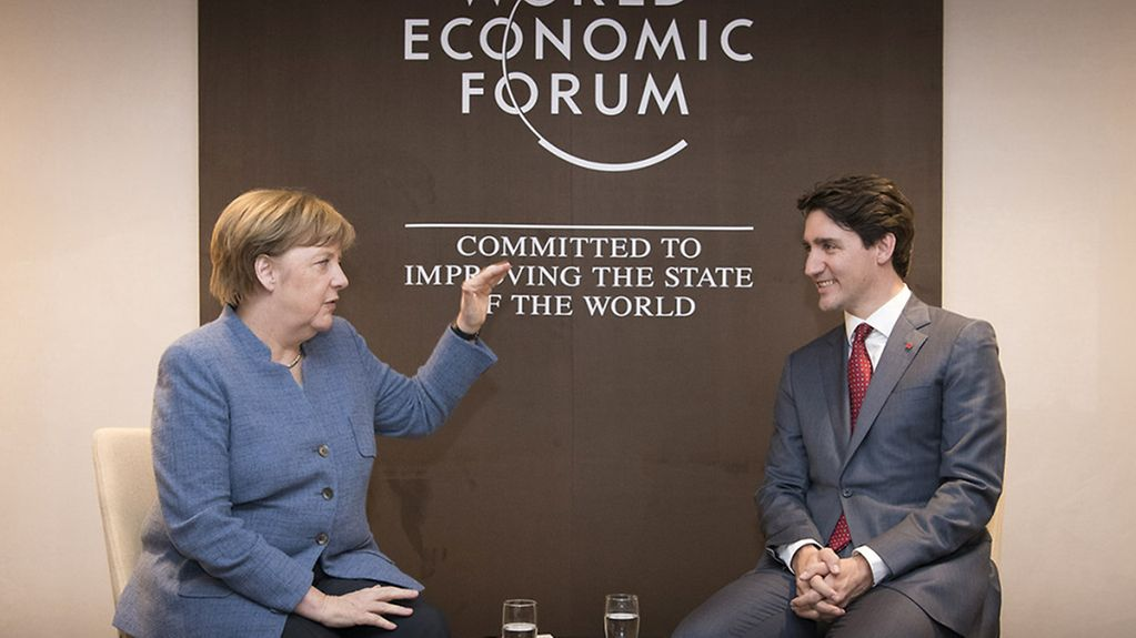 Chancellor Angela Merkel and Canadian Prime Minister Justin Trudeau deep in discussion at the World Economic Forum.