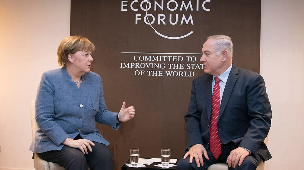 Chancellor Angela Merkel meets with Israeli Prime Minister Benjamin Netanyahu at the World Economic Forum in Davos.