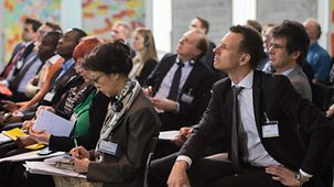 "Participants at the 3rd International German Forum listen to the presentation of ""Innovation Spotlights"", a number of international projects to promote global health."