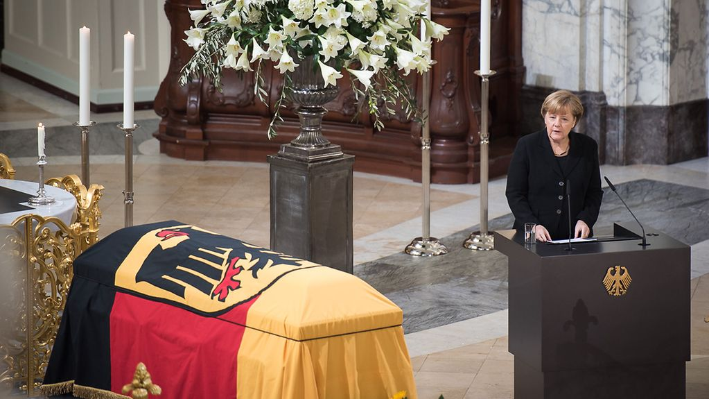Chancellor Angela Merkel speaks at the state funeral for former Chancellor Helmut Schmidt.
