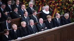 Family members and guests, including Chancellor Angela Merkel, in the front pew