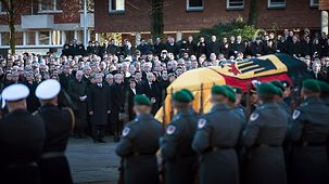 Paying their last respects in front of Hamburg's St. Michael's Church