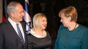 Israeli Prime Minister Benjamin Netanyahu and his wife Sara welcome the Chancellor.