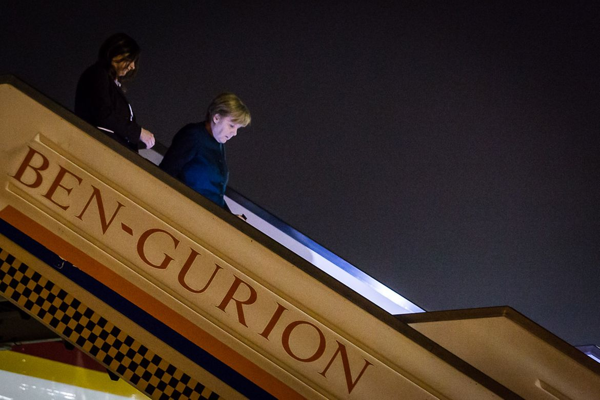 Chancellor Angela Merkel alights from the government aircraft at Ben Gurion Airport in Tel Aviv.