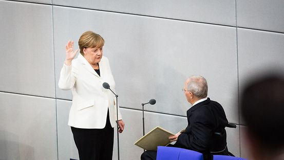 Chancellor Angela Merkel is sworn in by Bundestag President Wolfgang Schäuble in the German Bundestag.